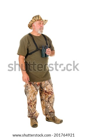 Older hunter in typical New Zealand hunting garb with binoculars isolated over white - stock photo