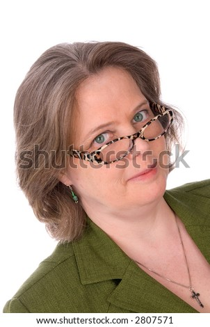 Older Irish woman with green outfit,glasses and green eyes isolated over white - stock photo