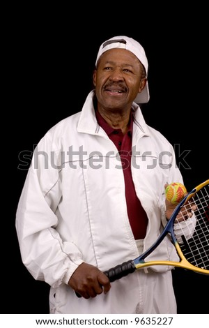 Older male african american tennis player in white sports outfit over black background
