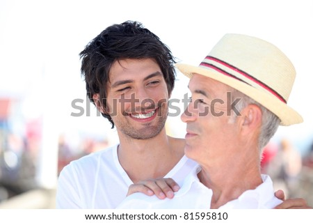 older man and younger man relationships - stock photo