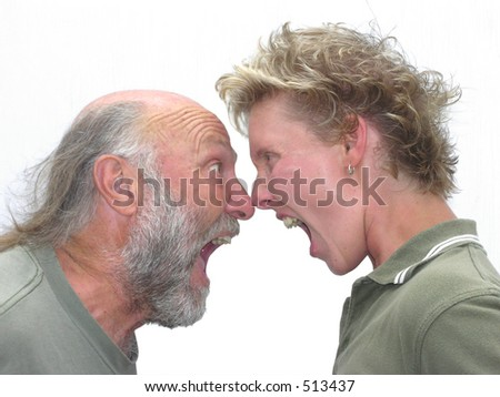 older man and younger woman yelling at each other - stock photo