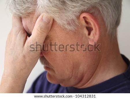 older man depressed or grieving - stock photo
