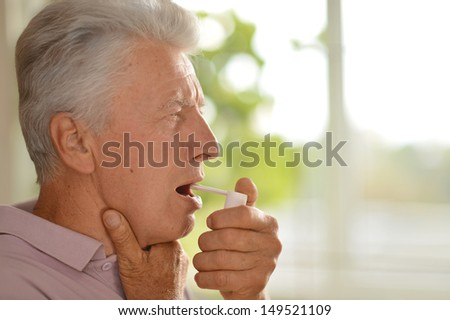 older man feels pain in the throat - stock photo