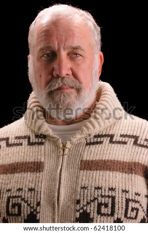 older man in a sweater looking like Ernest Hemingway - stock photo
