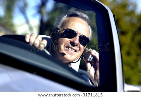 Older Man in convertible