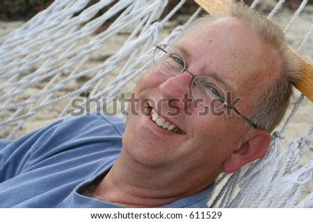 Older Man in Hammock - stock photo