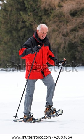 Older man in winter when snow shoe hiking