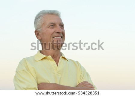older man on  background of the sky