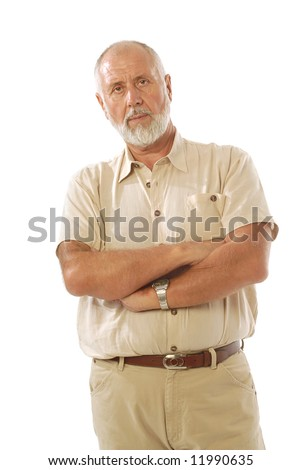 Older man standing with crossed arms and showing disapproval - stock photo