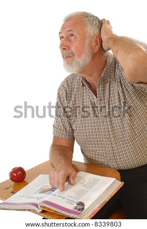 Older man trying to think while reading a textbook back in school