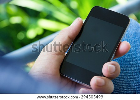 Older Man Using a Smart Phone - stock photo