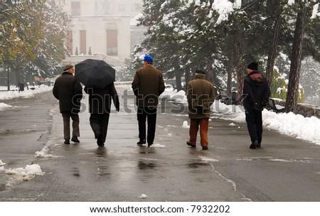 Older man walking at the park in December - stock photo