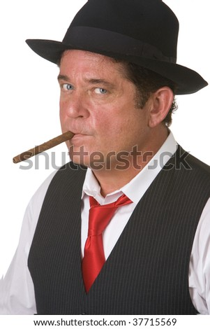 Older man with blue eyes wearing a hat smoking a cigar. Shot against a white background.