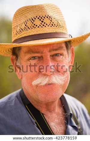 Older man with hat, smiling  - stock photo