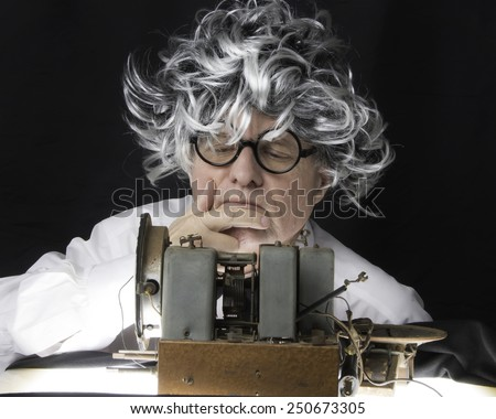 Older man with radio set/Radio Technician/Mature man working on a vintage radio - stock photo