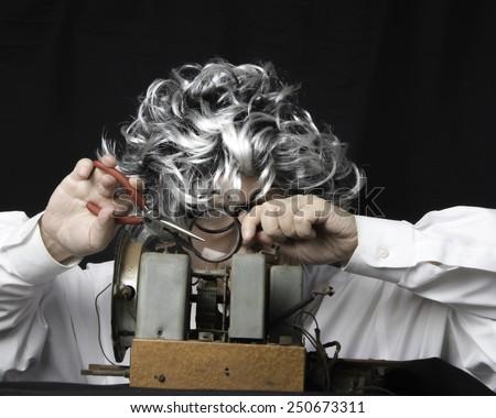 Older man with radio set/Radio Technician/Mature man working on a vintage radio - stock photo