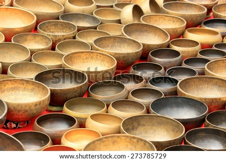 Older Nepalese musical instrument on the market, background - stock photo