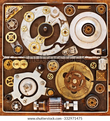 Older parts of mechanisms in the box. Abstract  collage of a mechanical device.
