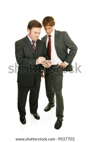 Older professional mentoring young businessman.  Full body isolated on white.