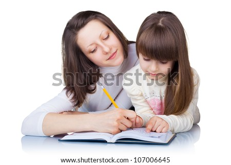 Older sister helps younger homework isolated on white background - stock photo