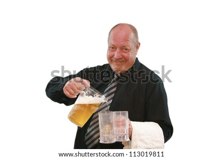 Older smiling bartender pouring beer into three mugs isolated on white. - stock photo