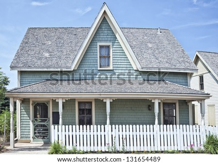 Older style North American family home possibly from the 1920's or 30's. - stock photo