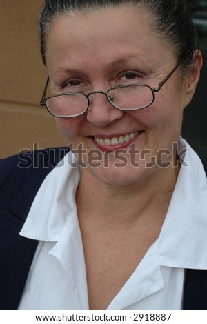Older woman at the brink of retirement - stock photo