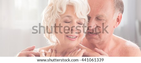 Older woman is dreamy when her husband is  touching her