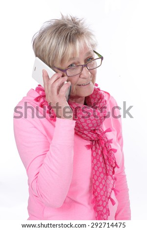 Older woman is talking on the mobile phone isolated