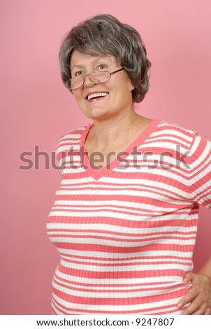 Older woman laughing heartily and having fun - stock photo
