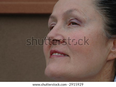Older woman looking forward, with copy space - stock photo