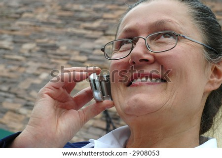 Older woman near retirement age still going strong at work - stock photo