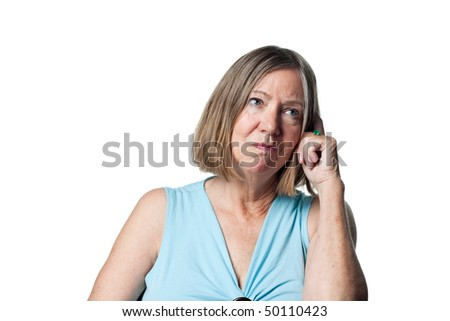Older woman totally confused, looking bemused - stock photo