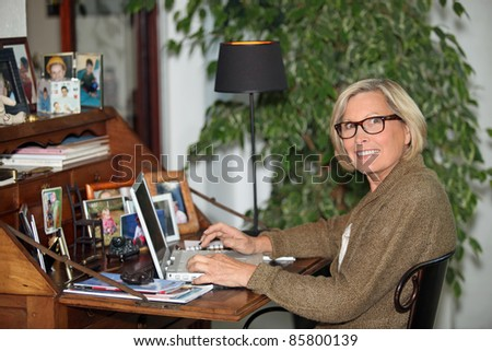 Older woman using a laptop - stock photo