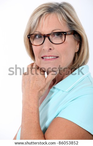 Older woman wearing glasses - stock photo