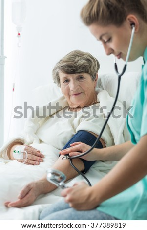 Older woman with hypertension and checking blood pressure