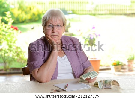 older woman with money - stock photo