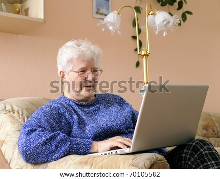 older woman working on laptop