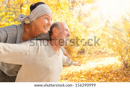 olderr couple in autum time - stock photo
