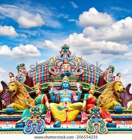 Oldest Hindu temple Sri Mariamman in Singapore over beautiful blue sky - stock photo
