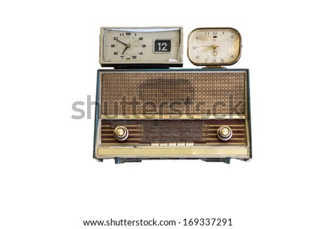 oldie radios and clock on white background - stock photo