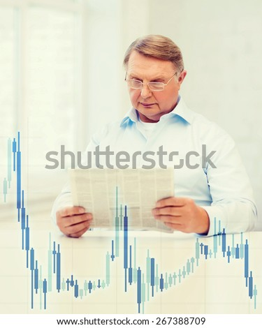 oldness, news, money and happiness concept - old man at home with newspaper and forex chart - stock photo