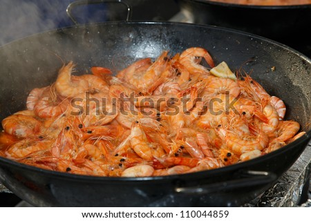 OLHAO, PORTUGAL - AUG 9: Workers cooking seafood at seafood event on August 9, 2012 in Olhao, Portugal.