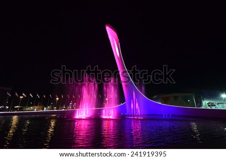 """OLIMPIC PARK, SOCHI, RUSSIA SEPTEMBER, 2014: The cup Olympic flame """"Firebird"""", mythological fire bird of Russian folklore with a swan neck and wings, embracing the bowl of an artificial lake. - stock photo"""
