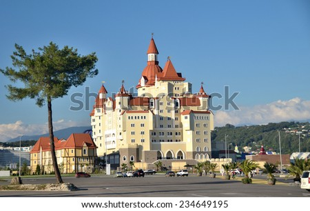 """OLIMPIC VILAGE, SOCHI, RUSSIA SEPTEMBER, 2014: Sochi adventure park, the hotel complex """"Bogatyr"""" , styled medieval castle. Built for the 2014 Olympic Games. - stock photo"""