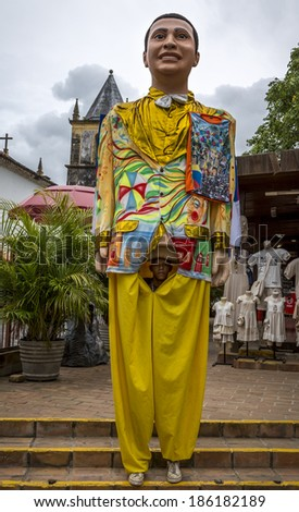 OLINDA, BRAZIL - APRIL 3: Colorful Giant Doll of Olinda's Carnival Festival is not only a local costume, but also a landmark of the state of Pernambuco in Brazil photographed on April 3, 2014. - stock photo
