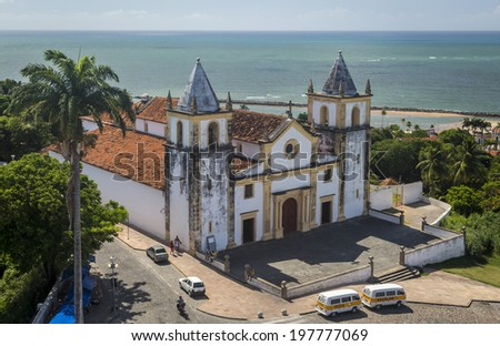 OLINDA, BRAZIL - MARCH 10: Aerial view of Olinda in PE, Brazil with its Se Cathedral dated from the 17th century and some locals passing by on March 10, 2014. - stock photo