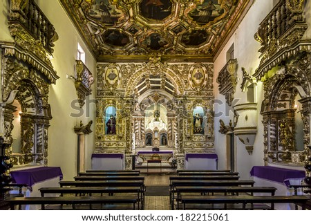 OLINDA, BRAZIL - MARCH 17, 2014: Interior view of the Saint Francis Convent church in Olinda, Pernambuco, Brazil showing its golden architecture and sculptures on March 17, 2014. - stock photo
