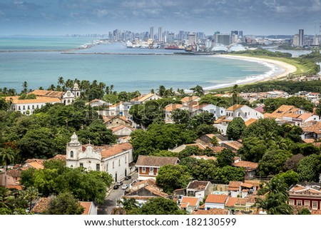 OLINDA, BRAZIL - MARCH 17, 2014: View of Olinda's historic buildings on the foreground and Recife's modern skyscrapers on the background on March 17, 2014. - stock photo