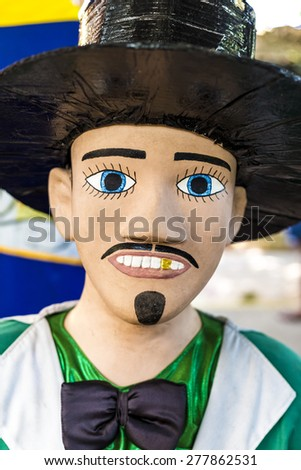 OLINDA, BRAZIL - MAY 14: Brazilian carnival festival costume wore in Olinda and Recife in PE, Brazil by locals during the festival made of fabric, paper, and wood photographed on May 14, 2015. - stock photo